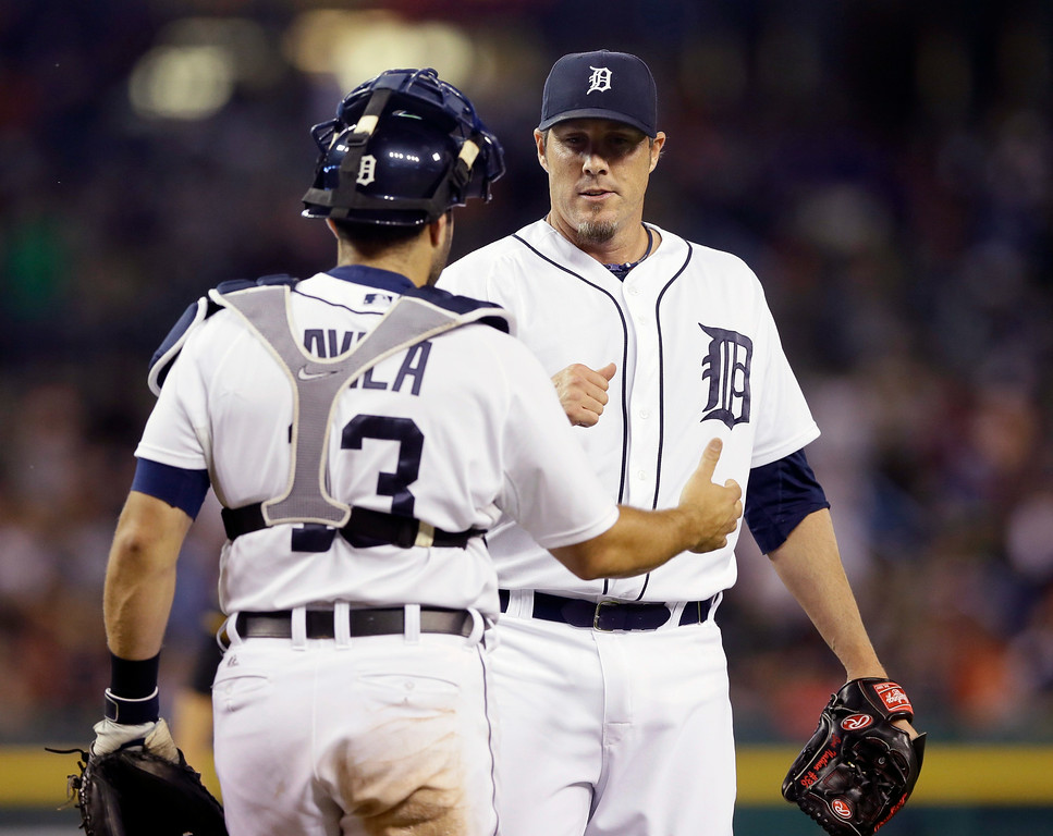 . Detroit Tigers catcher Alex Avila and relief pitcher Joe Nathan shake hands after their 8-4 win over the Pittsburgh Pirates in an interleague baseball game, Wednesday, Aug. 13, 2014 in Detroit. (AP Photo/Carlos Osorio)