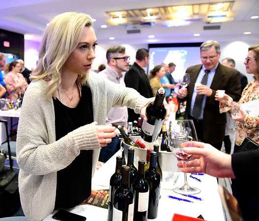 3/23/2019 Mike Orazzi | Staff Amber Frost pours wine during the Bristol Hospital Development Foundation's annual Festival of Wine and Spirits held at the DoubleTree by Hilton Hotel in Bristol Saturday night.