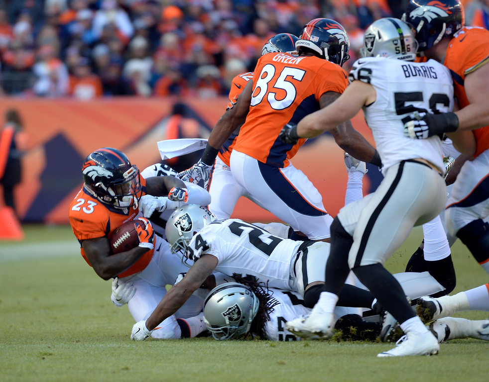 . DENVER, CO - DECEMBER 28: Ronnie Hillman (23) of the Denver Broncos gets caught near the line of scrimmage during the first quarter.  The Denver Broncos played the Oakland Raiders at Sports Authority Field at Mile High in Denver on December, 28 2014. (Photo by Joe Amon/The Denver Post)