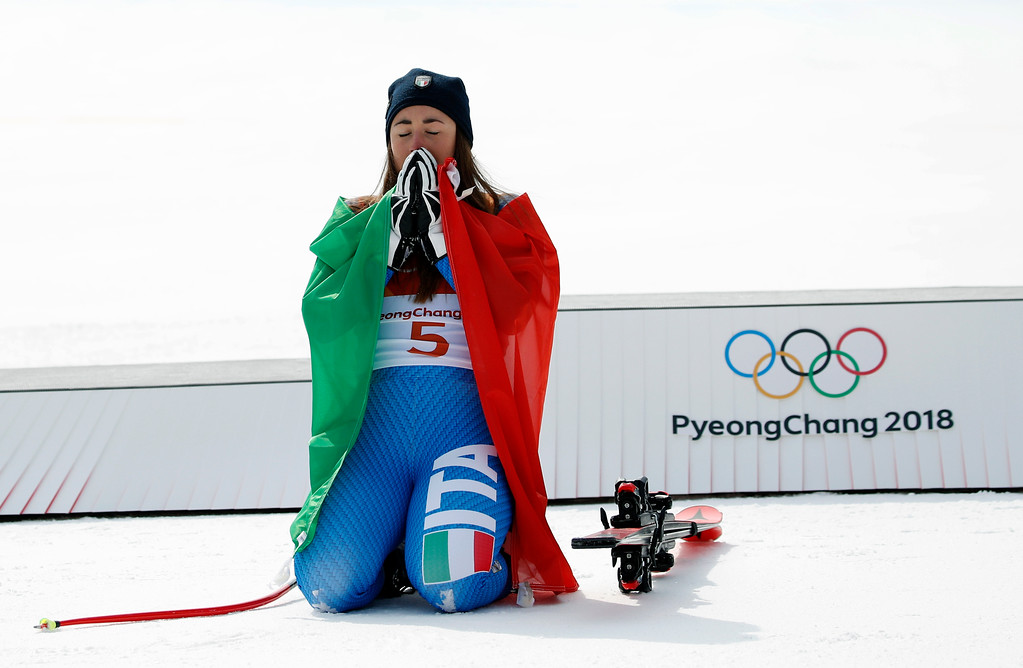 . Gold medal winner Sofia Goggia, of Italy, reacts after the flower ceremony for the women\'s downhill at the 2018 Winter Olympics in Jeongseon, South Korea, Wednesday, Feb. 21, 2018. (AP Photo/Christophe Ena)