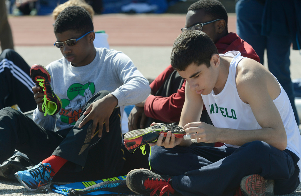 . Maribeth Joeright/MJoeright@News-Herald.com<p> Mayfield\'s Washawn Collins, left, and Anthony Gamerman clean their cleats as they prepare for their upcoming events at the Hilltopper Invitational track meet. Collins was preparing for the 110 meter hurdles and Gamerman for the pole vault.