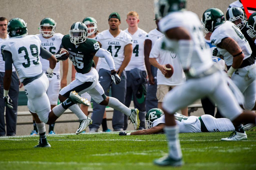 . Michigan State wide receiver Macgarrett Kings Jr. shakes a tackle as he runs up the sideline during the first half on Saturday, Sept. 20, 2014 at Spartan Stadium in East Lansing, Mich. (AP Photo/The Flint Journal, Jake May)