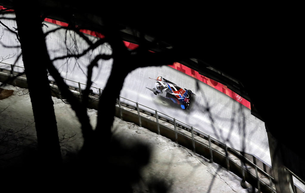 . Driver Jamie Greubel Poser and Aja Evans of the United States take a curve in their second heat during the women\'s two-man bobsled competition at the 2018 Winter Olympics in Pyeongchang, South Korea, Tuesday, Feb. 20, 2018. (AP Photo/Wong Maye-E)