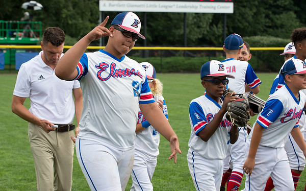 08/06/19 Wesley Bunnell | Staff New Jersey defeated Maryland in a Mid-Atlantic Little League tournament game on Tuesday afternoon at Breen Field in Bristol. Yady Mateo (28) motions while running off the field with teammates after a team meeting.