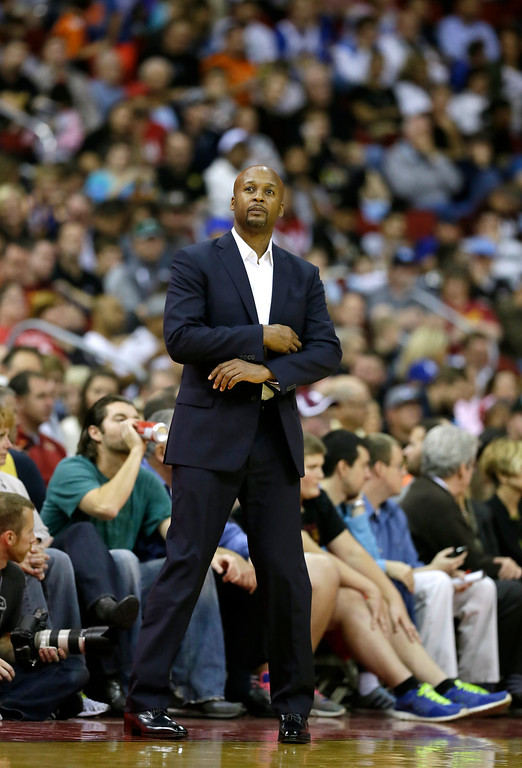 . Denver Nuggets coach Brian Shaw watches during the second half of the Nuggets\' preseason NBA basketball game against the Golden State Warriors, Thursday, Oct. 16, 2014, in Des Moines, Iowa. Golden State won 104-101. (AP Photo/Charlie Neibergall)