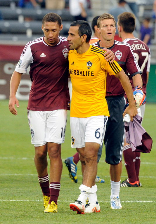 . Rapids defender Christopher Klute, left, talked with former teammate Pablo Mastroeni, right, following the game. The Colorado Rapids defeated the Los Angeles Galaxy 2-0 Saturday, July 27, 2013.  Photo By Karl Gehring/The Denver Post