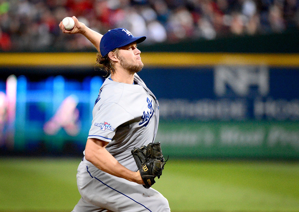 . Los Angeles Dodgers\' Clayton Kershaw pitches in the fifth inning where he strikes out three straight players after getting out  with bases loaded as they play the Atlanta Braves in the first game of the playoffs Thursday, October 3, 2013 at Turner Field in Atlanta, Georgia. (Photo by Sarah Reingewirtz/Pasadena Star- News)