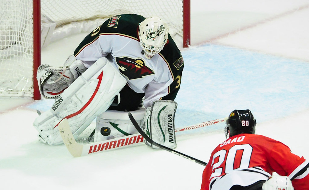 . Wild goalie Josh Harding makes a save on a shot by Chicago\'s Brandon Saad in the third period. Harding stopped 35 of 37 shots in relief of injured teammate Niklas Backstrom in the Blackhawks\' 2-1 overtime win. (Pioneer Press: Ben Garvin)