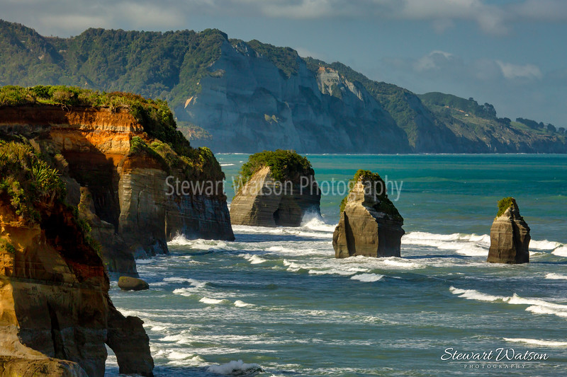 The 3 sisters at Tongaporutu with Mt Taranaki in the distance