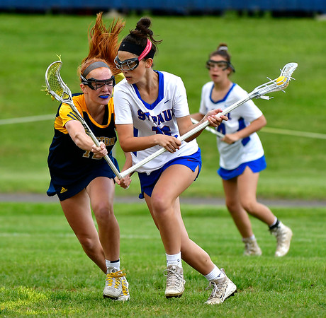 5/29/2019 Mike Orazzi | Staff St. Paul's Greta Panke (16) and Weston's Taylor Werner (12) during Wednesday's Class S First Round lacrosse match in Bristol.