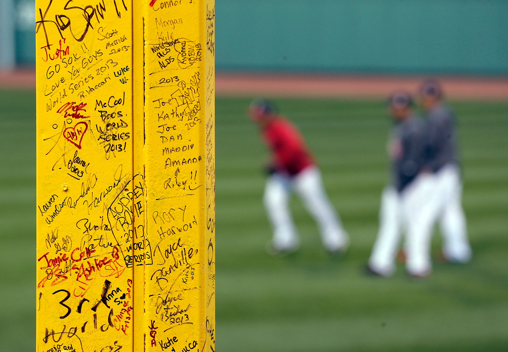 ". Fans\' signatures are seen on the ""Pesky\'s Pole\"" in the right field as the Boston Red Sox practice before Game 2 of baseball\'s World Series against the St. Louis Cardinals Thursday, Oct. 24, 2013, at Fenway Park in Boston. (AP Photo/Charlie Riedel)"