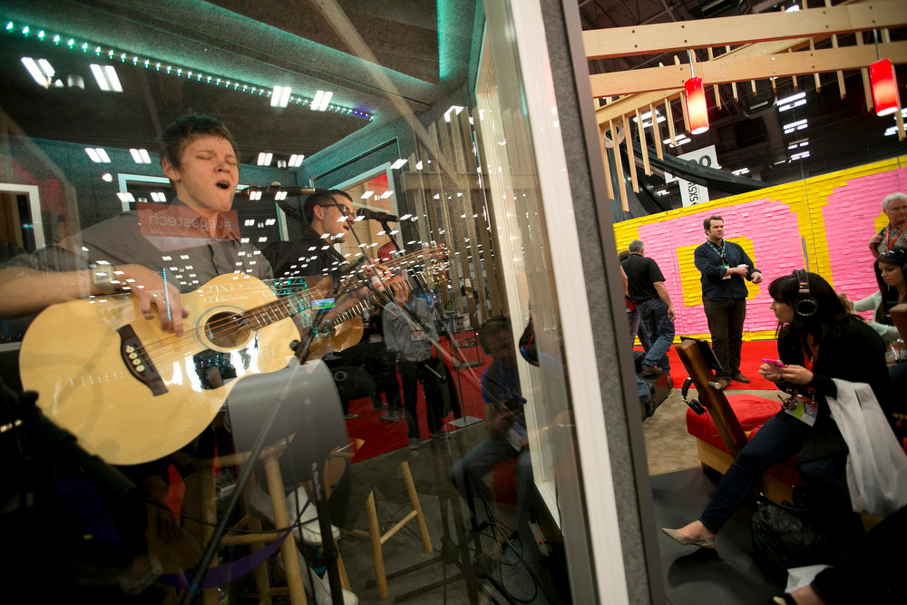 """. The band Speak plays at the Polk Audio booth at the SXSW Interactive Festival trade show on Monday, March 11, 2013. The booth was billed as \""""Bands in a Box\"""" and allowed attendees to put on Polk Audio headphones to hear the band.  (AP Photo/Statesman.com, Deborah Cannon)"""