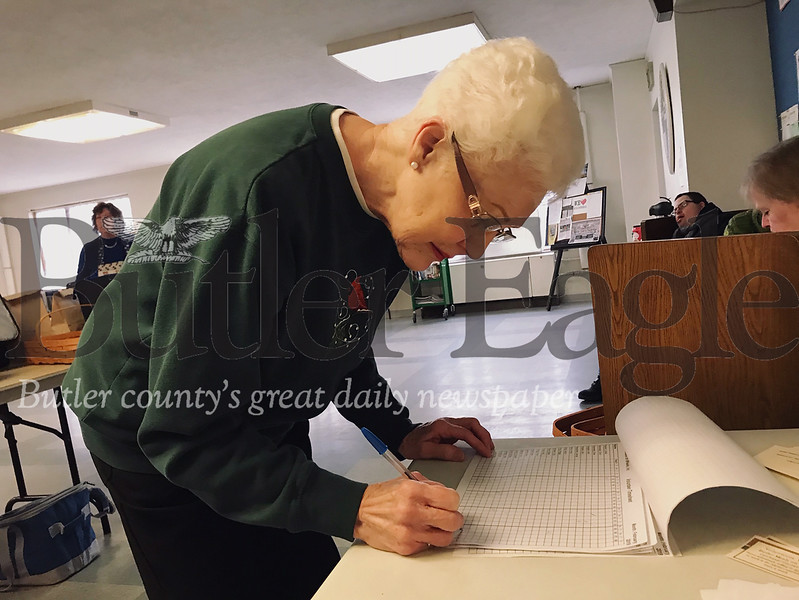 Butler resident Peggy Loomis signs in Tuesday to deliver meals for Butler Meals on Wheels.