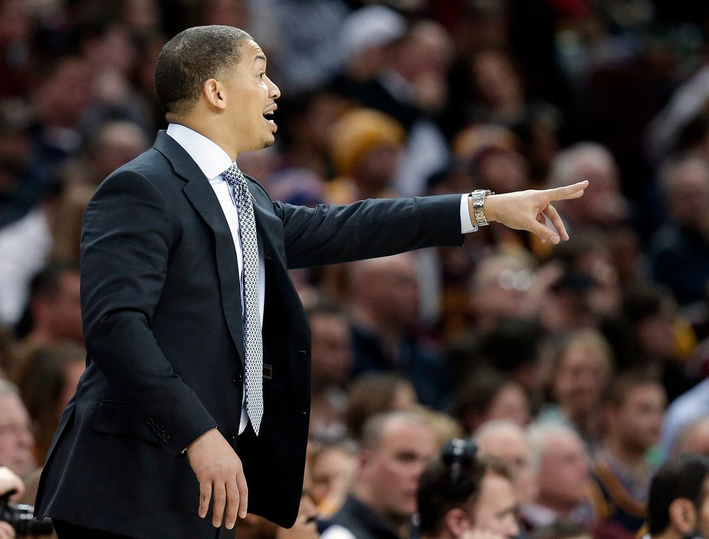 . Cleveland Cavaliers head coach Tyronn Lue yells to players in the second half of an NBA basketball game against the Minnesota Timberwolves, Monday, Jan. 25, 2016, in Cleveland. The Cavaliers won 114-107. (AP Photo/Tony Dejak)