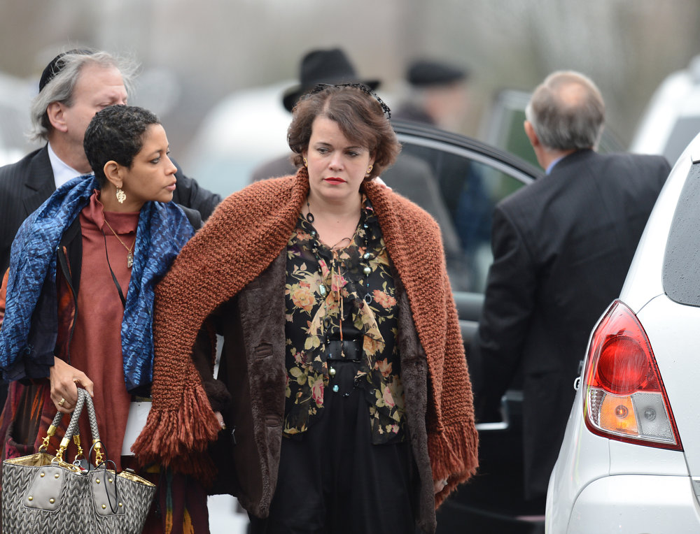 Description of . Veronika Pozner, mother of Noah Pozner, arrives for her son's funeral December 17, 2012 at the Abraham L. Green and Son Funeral Home in Fairfield, Connecticut. Pozner, a six year-old Jewish boy who, along with 19 other classmates and 6 teachers was murdered by a lone gunman December 14 at the Sandy Hook Elementary School in Newtown, Connecticut.  AFP PHOTO / Don  EMMERT/AFP/Getty Images