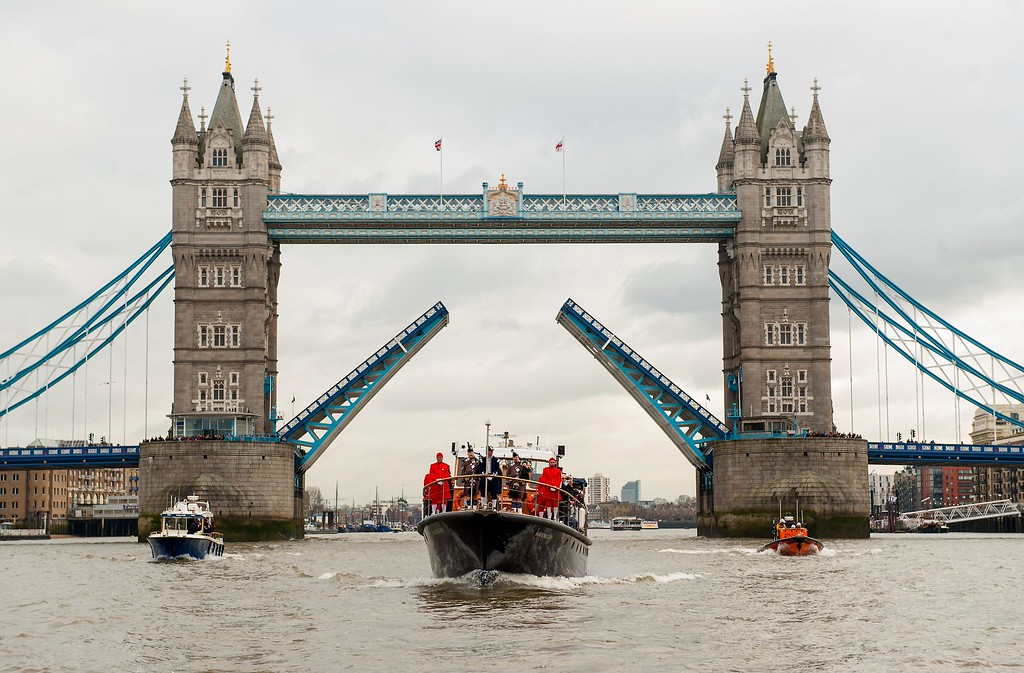 . The Havengore carrying a wreath sails through the raised Tower Bridge during a re-enactment of Winston Chrurchill\'s funeral procession, 50 years to the day since it was watched on television by 350 million people, in London on January 30, 2015. Fifty years after Winston Churchill\'s death, the wartime prime minister remains a touchstone of British political life -- and a reminder of a faded age of global influence. AFP PHOTO / POOL / DOMINIC  Lipinski/AFP/Getty Images