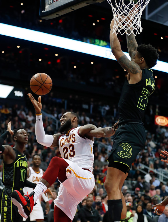 . Cleveland Cavaliers forward LeBron James (23) loses control of the ball as he goes up for a basket shot Atlanta Hawks forward John Collins (20) during the second half of an NBA basketball game Friday, Feb. 9, 2018, in Atlanta. Cleveland won 123-107. (AP Photo/John Bazemore)