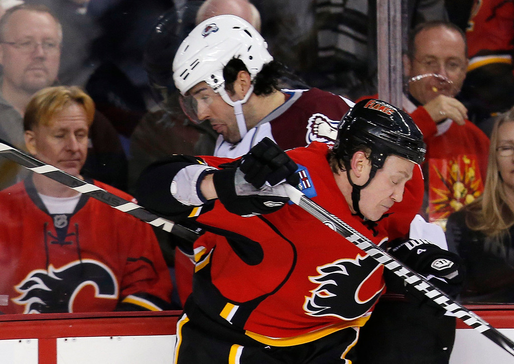 . Calgary Flames\' Jay Bouwmeester (R) hits Colorado Avalanche\' Ryan O\'Byrne during the second period of their NHL hockey game in Calgary, Alberta, January 31, 2013. REUTERS/Todd Korol