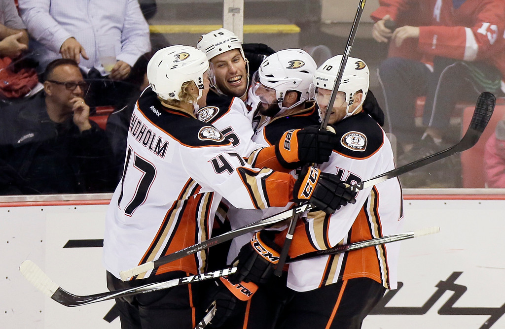 . Anaheim Ducks\' Ryan Getzlaf (15) celebrates his game-winning goal with teammates Hampus Lindholm (47), of Sweden, Ryan Kesler (17) and Corey Perry (10) during the third period of an NHL hockey game against the Detroit Red Wings Saturday, Oct. 11, 2014, in Detroit. The Ducks defeated the Red Wings 3-2. (AP Photo/Duane Burleson)