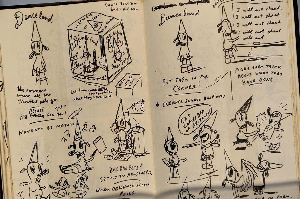 . One of Gary Baseman\'s sketch books on display. (Michael Owen Baker/Staff Photographer)