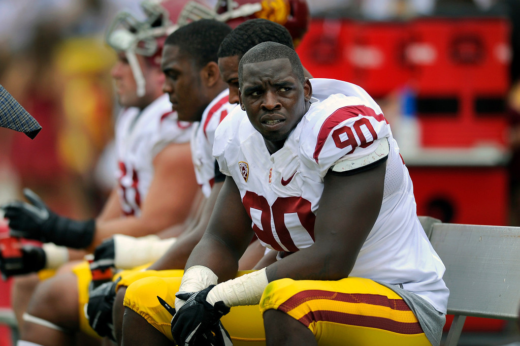 . DT George Uko sits on the sidelines at USC\'s Spring Football Game. (Michael Owen Baker/Staff Photographer)