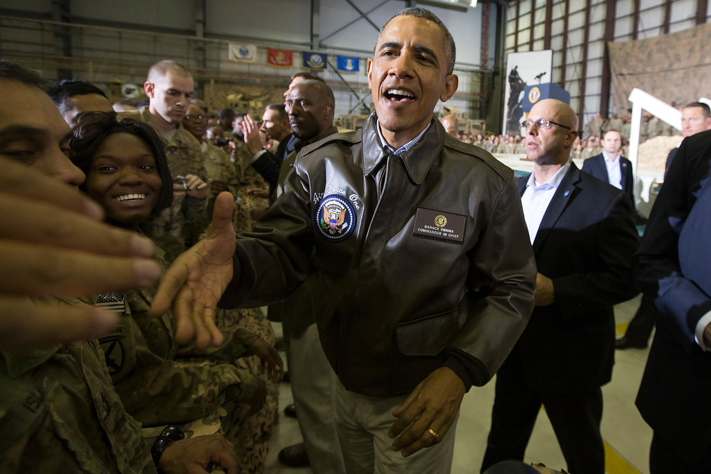 . President Barack Obama shakes hands during a troop rally at Bagram Air Field during an unannounced visit, on Sunday, May 25, 2014, north of Kabul, Afghanistan. (AP Photo/ Evan Vucci)