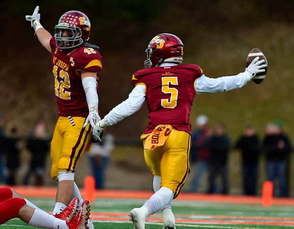 12/8/2018 Mike Orazzi | Staff St. Joseph's Cole daSilva (42) and Davee Silas (5) during Saturday's Class M Football State Football Championship with Berlin at Shelton High School. St. Joseph won St. Joseph 70 to 18.