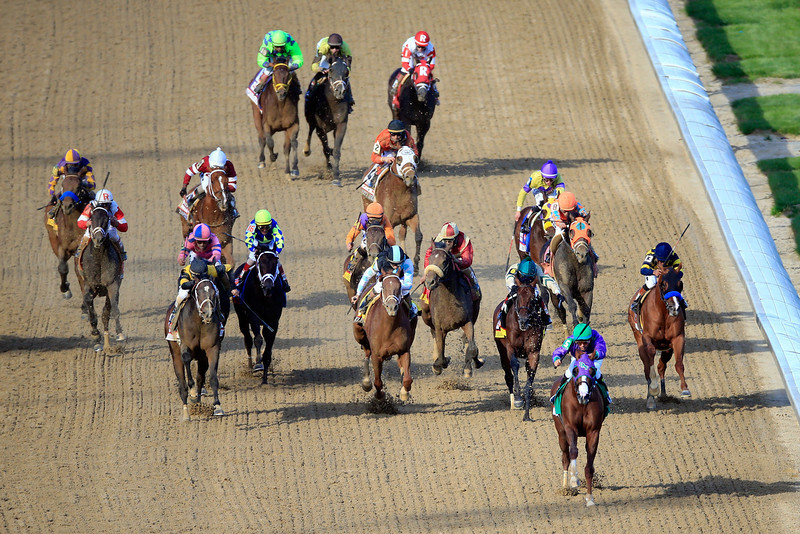 . California Chrome with Victor Espinoza leads the field to the finish line to win the 140th running of the Kentucky Derby at Churchill Downs on May 3, 2014 in Louisville, Kentucky.  (Photo by Jamie Squire/Getty Images)