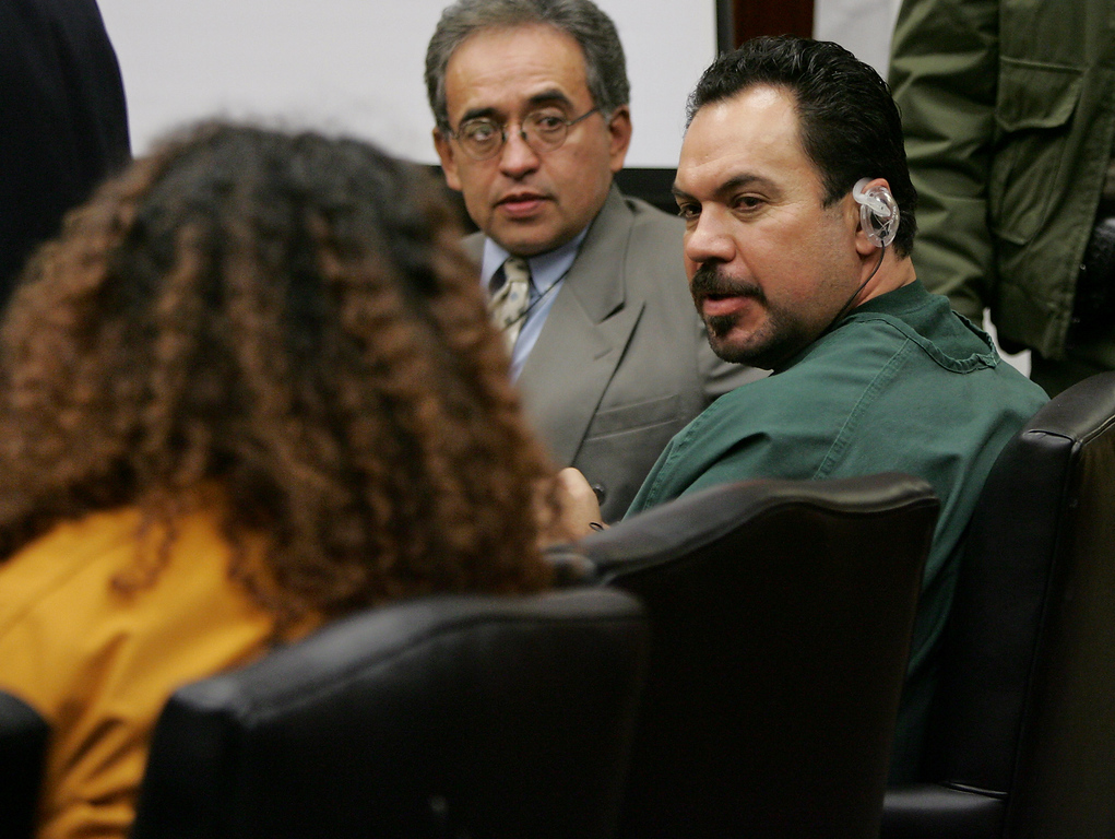. Anna Ayala, left, and her husband, Jaime Plascencia, right, exchange words after they were sentenced in a Santa Clara County Superior Court in a San Jose, Calif., courtroom, Wednesday, Jan. 18, 2006.  Ayala and Plascencia, who cooked up a scheme last March to plant a severed finger in a bowl of Wendy\'s chili to extort money from the fast food chain were sentenced to Wednesday. Ayala, 40, was sentenced to nine years and Plascencia was sentenced to more than 12 years. In center is an unidentified interpreter. (AP Photo/Paul Sakuma)
