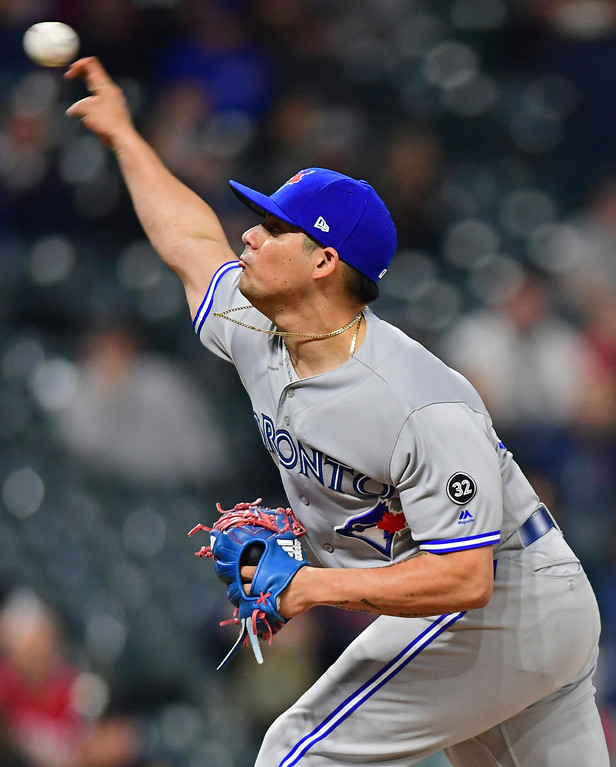 . Toronto Blue Jays relief pitcher Roberto Osuna delivers in the ninth inning of a baseball game against the Cleveland Indians, Friday, April 13, 2018, in Cleveland. The Blue Jays won 8-4. (AP Photo/David Dermer)