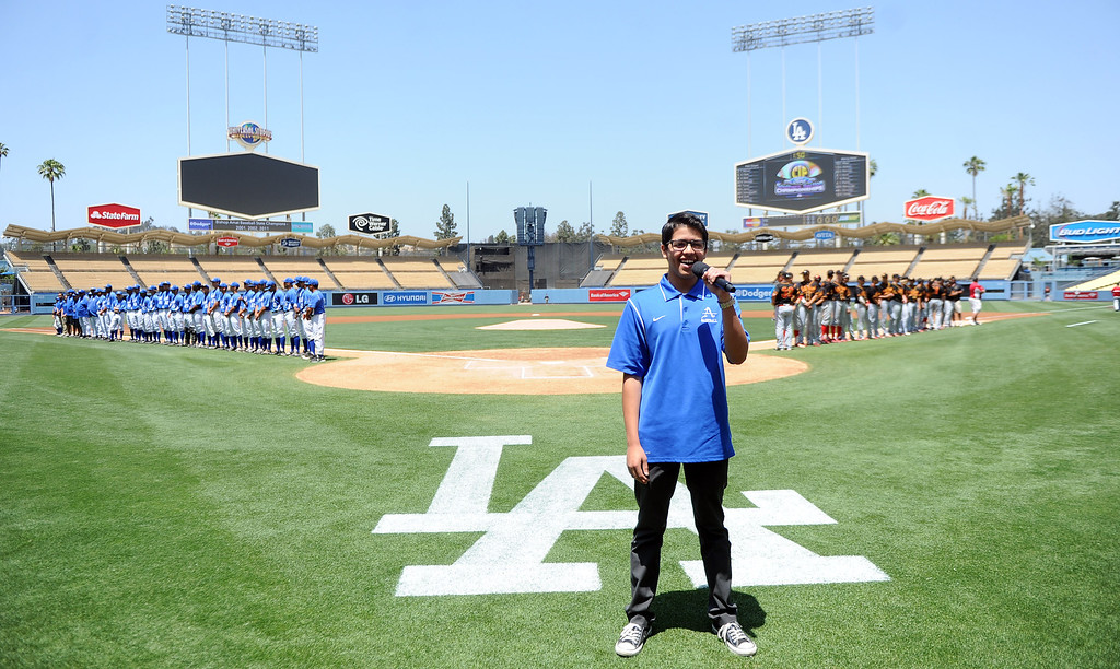 . Former Bishop Amat student Jesse Lopez sings the National Anthem prior to a CIF-SS Division 3 baseball championship between Palm Desert and Bishop Amat at Dodger Stadium in Los Angeles on Friday, June 6, 2014. Bishop Amat won 4-3. 
