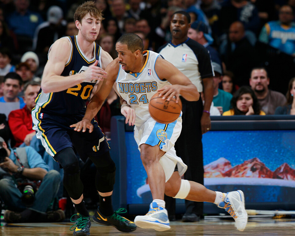 . Denver Nuggets guard Andre Miller, right, works ball inside as Utah Jazz guard Gordon Hayward covers in the fourth quarter of Utah\'s 103-93 victory in an NBA basketball game in Denver on Friday, Dec. 13, 2013. (AP Photo/David Zalubowski)