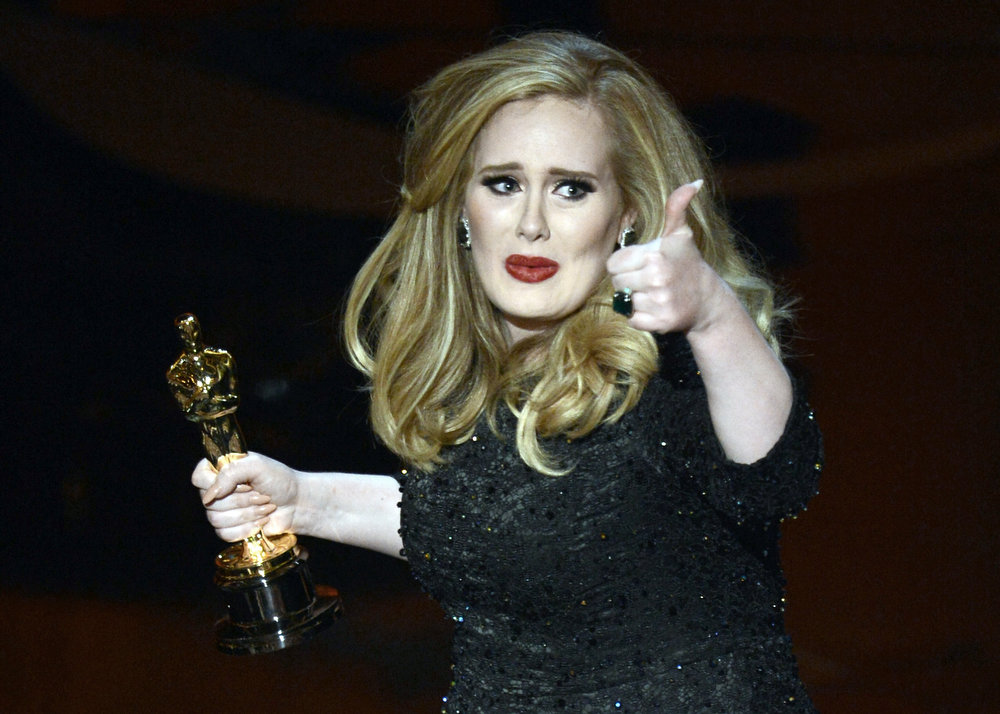 ". Singer Adele Adkins accepts the Best Original Song award for Skyfall from ""Skyfall\"" onstage during the Oscars held at the Dolby Theatre on February 24, 2013 in Hollywood, California.  (Photo by Kevin Winter/Getty Images)"