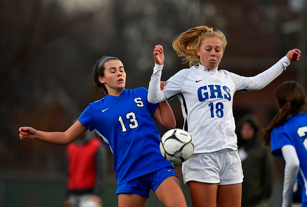 11/23/2019 Mike Orazzi | Staff Southington High School's Maya Wroblewski (13) and Glastonbury's Madison McGraw (18) during the Class LL Girls State Soccer Tournament at Veterans Stadium in New Britain Saturday evening. Glastonbury won 1-0.