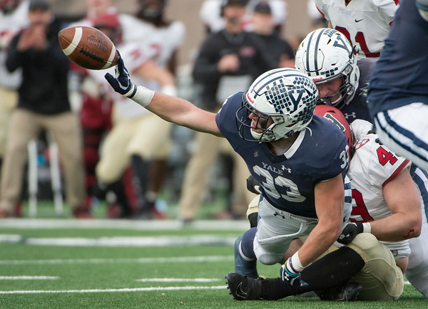 11/23/19 Wesley Bunnell | StaffrrYale rallied late in The Game against Harvard on Saturday afternoon at the Yale Bowl for a 50-43 victory in double over time. RB Zane Dudek (33) attempts to lateral back to QB Kurt Rawlings (6) but Dudek would be ruled down.