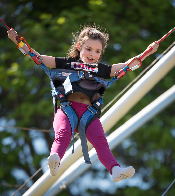 . Kaitlyn Fogg, 5, of Westford, enjoys the Bungy Jump as her father, Chris, (not shown) looks on.  Photo: SUN/Scot Langdon