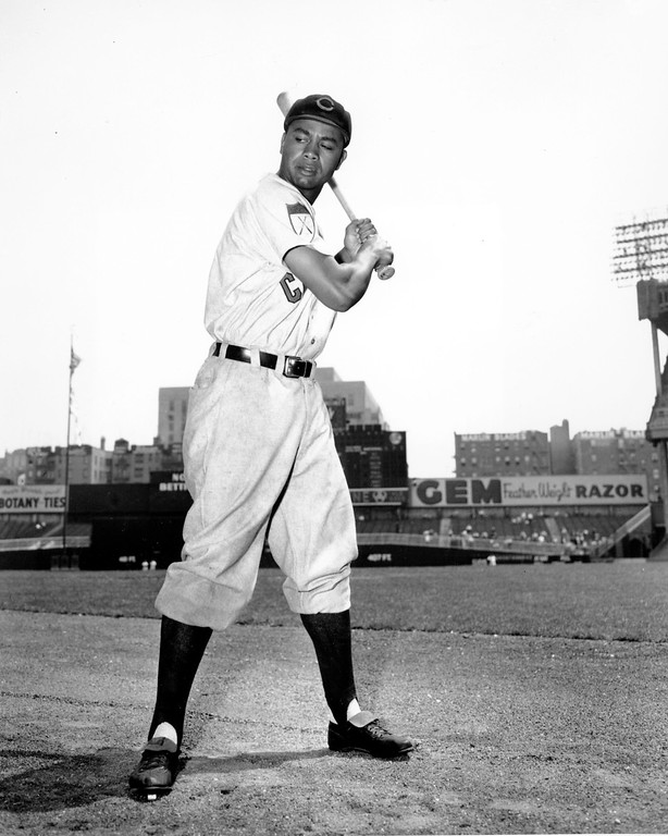 . Larry Doby, first black in the American League, poses proudly in his Cleveland Indians uniform on May 16, 1951.  (AP Photo)