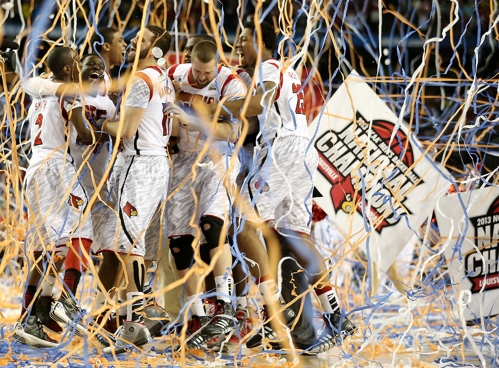. The Louisville Cardinals celebrate after they won 82-76 against the Michigan Wolverines during the 2013 NCAA Men\'s Final Four Championship at the Georgia Dome on April 8, 2013 in Atlanta, Georgia.  (Photo by Andy Lyons/Getty Images)