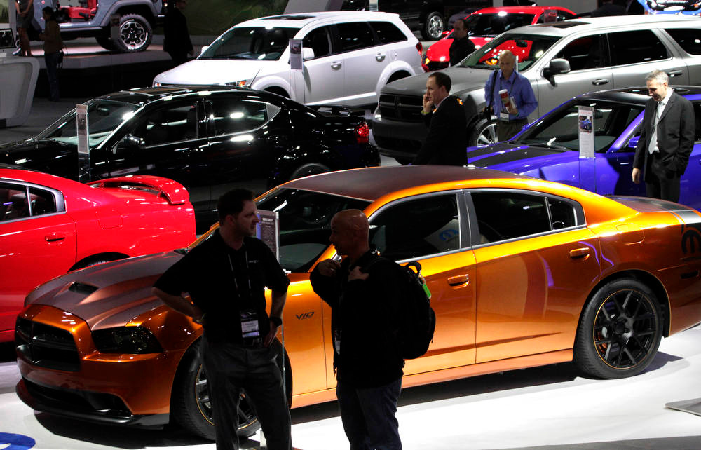 . Automobiles stand on display on the floor of the LA Auto Show in Los Angeles, California, U.S., on Wednesday, Nov. 28, 2012. The LA Auto Show is open to the public Nov. 30 through Dec. 9. Photographer: Jonathan Alcorn/Bloomberg