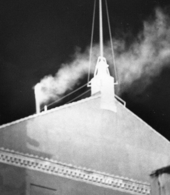 . FILE - This Oct. 16, 1978 file photo shows white smoke pouring out of the chimney atop the Sistine Chapel at 18.18 local time indicating that the conclavists have elected a successor to late Pope John Paul I. Cardinal Karol Wojtyla, archbishop of Krakow, Poland, was elected pontiff and took the name of Pope John Paul II. The papal conclave is steeped in mystery � and the church likes it that way. Elaborate ritual and veils of secrecy, after all, are fundamental to the papal mystique, seen as the glue the binds worshipers in faith. (AP Photo)