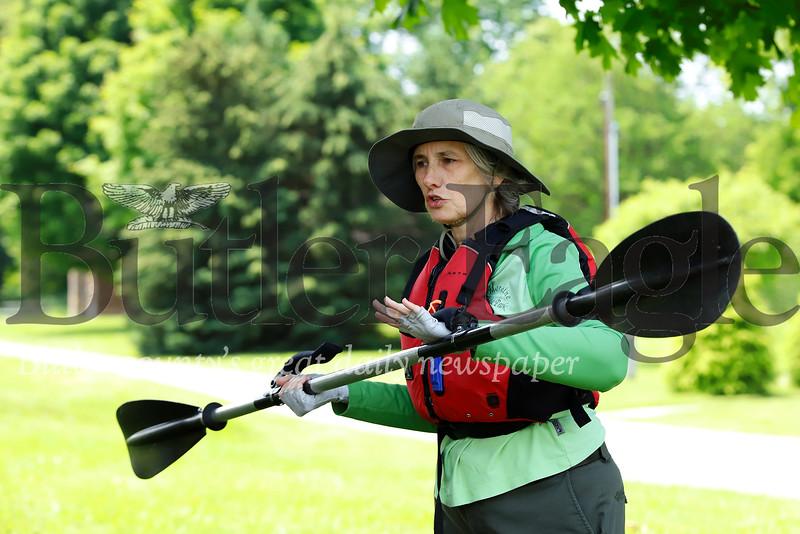 Natalie Simon, environmental education specialist for the DCNR, teaches senior center members on the basics of kayaking on land prior to paddling on Lake Arthur. Seb Foltz/Butler Eagle