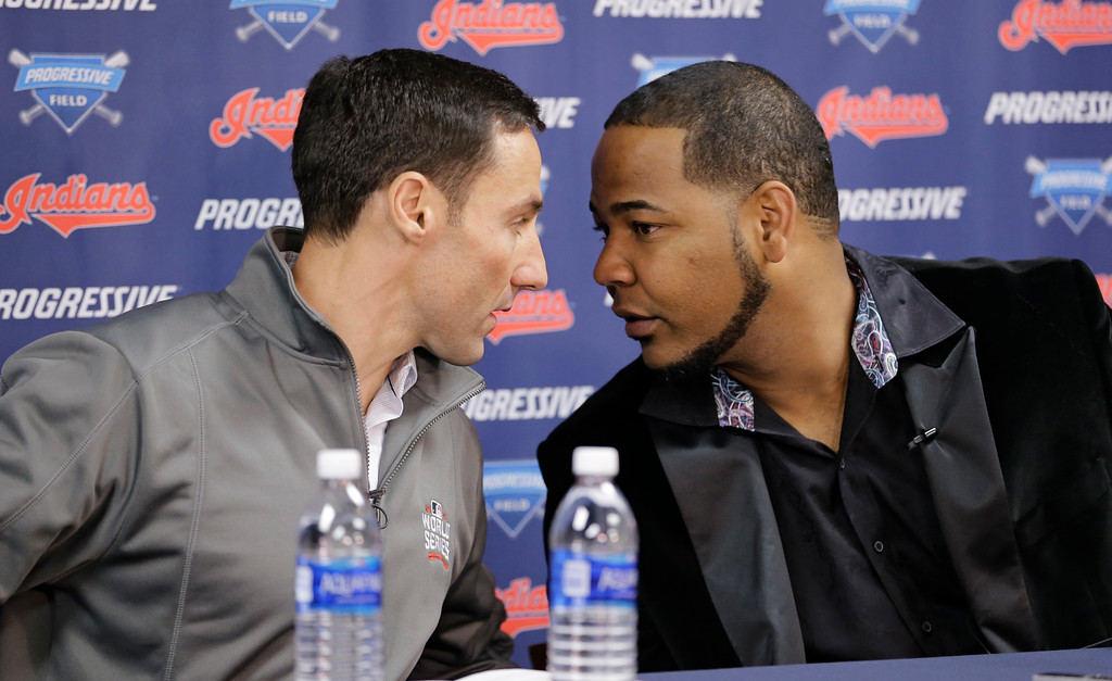 . Cleveland Indians president of baseball operations Chris Antonetti, left, and Edwin Encarnacion talk during a news conference, Thursday, Jan. 5, 2017, in Cleveland. One win from a World Series title last season, the Indians finalized a $65 million, three-year contract with free agent slugger Encarnacion. (AP Photo/Tony Dejak)