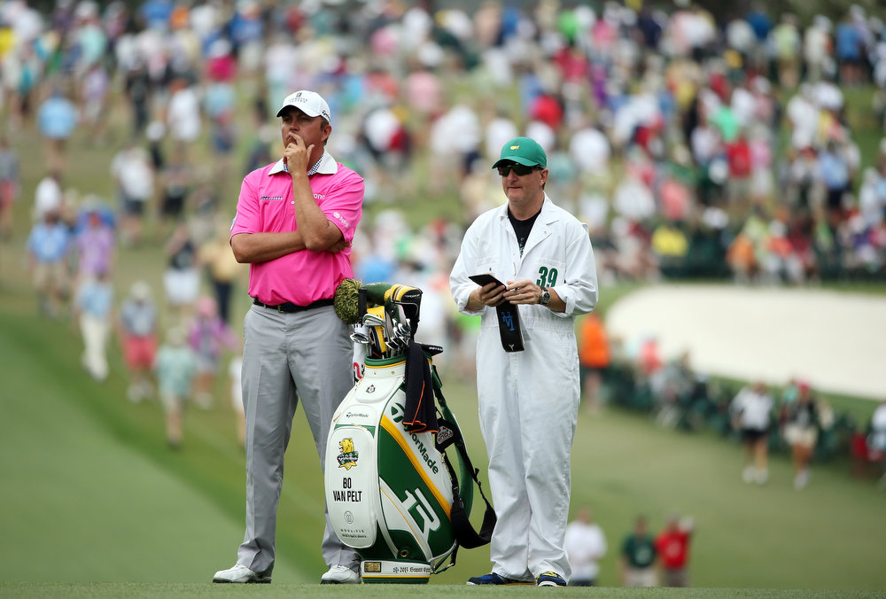 . Bo Van Pelt of the United States and caddie Mark Chaney look on from the first green during the final round of the 2013 Masters Tournament at Augusta National Golf Club on April 14, 2013 in Augusta, Georgia.  (Photo by Andrew Redington/Getty Images)
