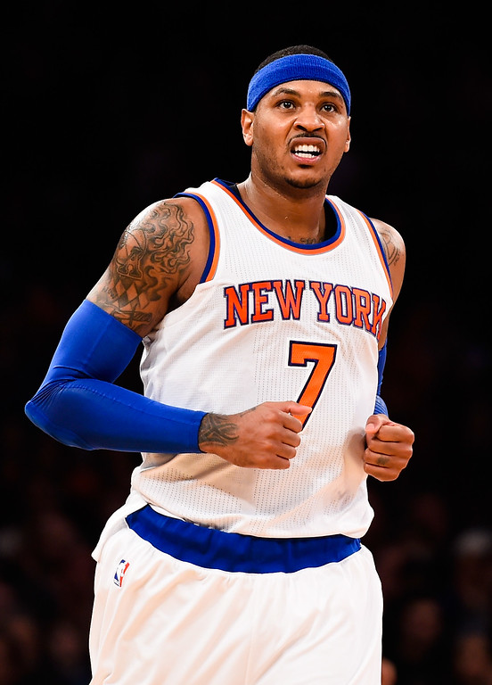. NEW YORK, NY - NOVEMBER 16: Carmelo Anthony #7 of the New York Knicks looks on in the first half during a game against the Denver Nuggets at Madison Square Garden on November 16, 2014 in New York City. NOTE TO USER: User expressly acknowledges and agrees that, by downloading and/or using this photograph, user is consenting to the terms and conditions of the Getty Images License Agreement.  (Photo by Alex Goodlett/Getty Images)