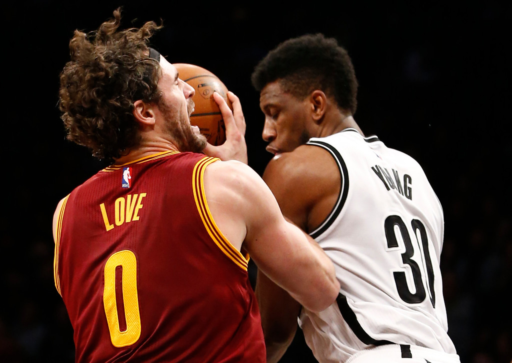 . Brooklyn Nets forward Thaddeus Young (30) interrupts Cleveland Cavaliers forward Kevin Love (0) who drives to the basket in the first half of an NBA basketball game, Wednesday, Jan. 20, 2016, in New York. (AP Photo/Kathy Willens)