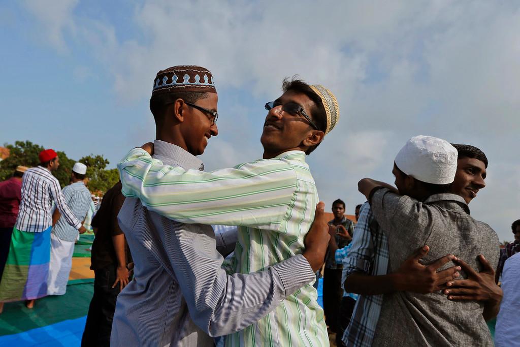 . Sri Lankan Muslim men greet each other as they celebrate Eid al-Adha in Puttalam, Sri Lanka, Wednesday, Oct. 16, 2013. (AP Photo/Eranga Jayawardena)