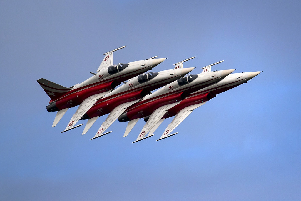 ". Fighter jets of the ""Patrouille Suisse\"" (Swiss patrol) perform on August 30, 2014 during the first day of AIR14 airshow in Payerne, western Switzerland.  AFP PHOTO / FABRICE  COFFRINI/AFP/Getty Images"
