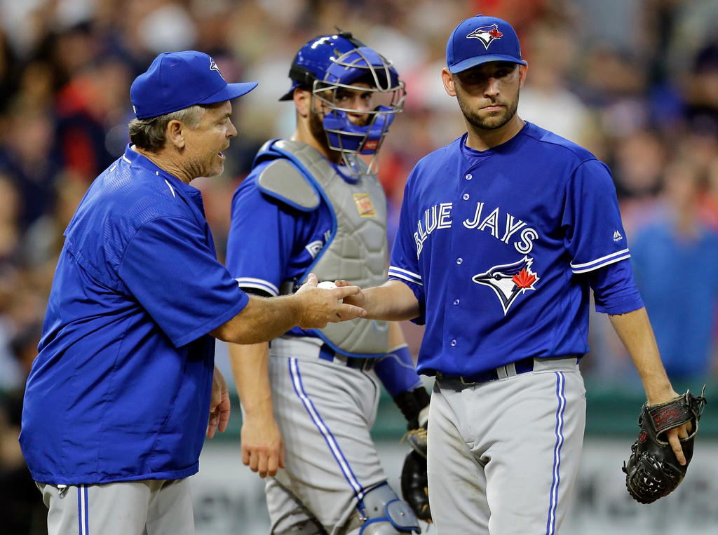 . Toronto Blue Jays manager John Gibbons, left, takes the ball from starting pitcher Marco Estrada during the fifth inning against the Cleveland Indians in a baseball game, Friday, July 21, 2017, in Cleveland. (AP Photo/Tony Dejak)