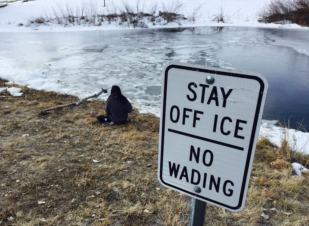 . A sign is shown at the banks of a pond Friday morning. Legend High School photography student Taylor Walker visited the site Friday morning, January 15, 2016. (Photo by Kenneth D. Lyons/The Denver Post)