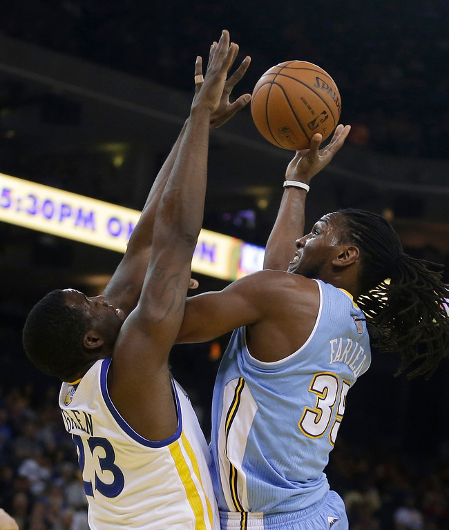 . Denver Nuggets\' Kenneth Faried, right, shoots against Golden State Warriors\' Draymond Green during the first half of an NBA basketball game Thursday, April 10, 2014, in Oakland, Calif. (AP Photo/Ben Margot)